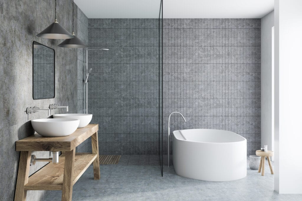 Gray tile bathroom interior with a concrete floor, a white bathtub, a double sink standing on a wooden shelf and a shower. 3d rendering mock up
