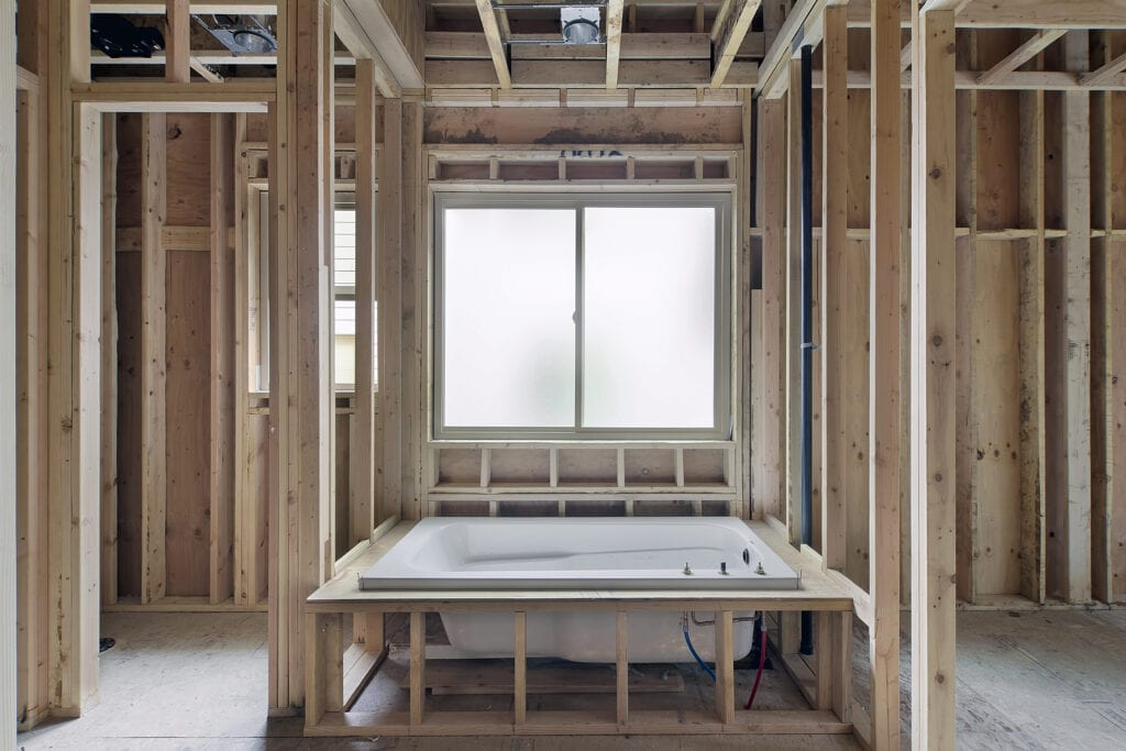 Installation of Soaking Bathtub in Master Bedroom Suite of New Home Construction