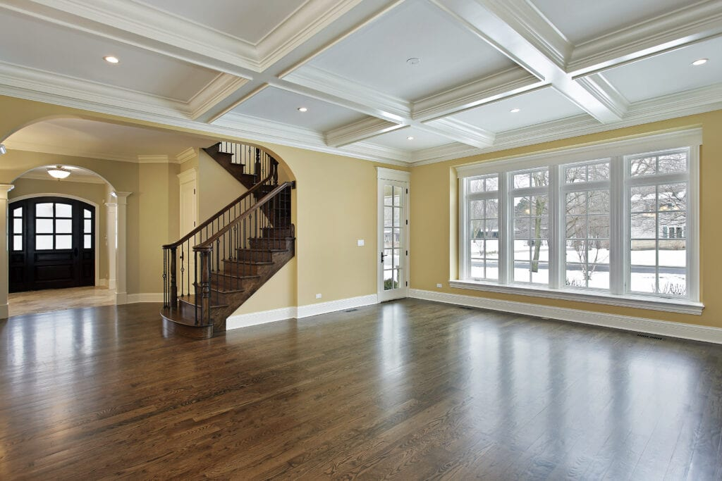 Family room in new construction home with view into foyer