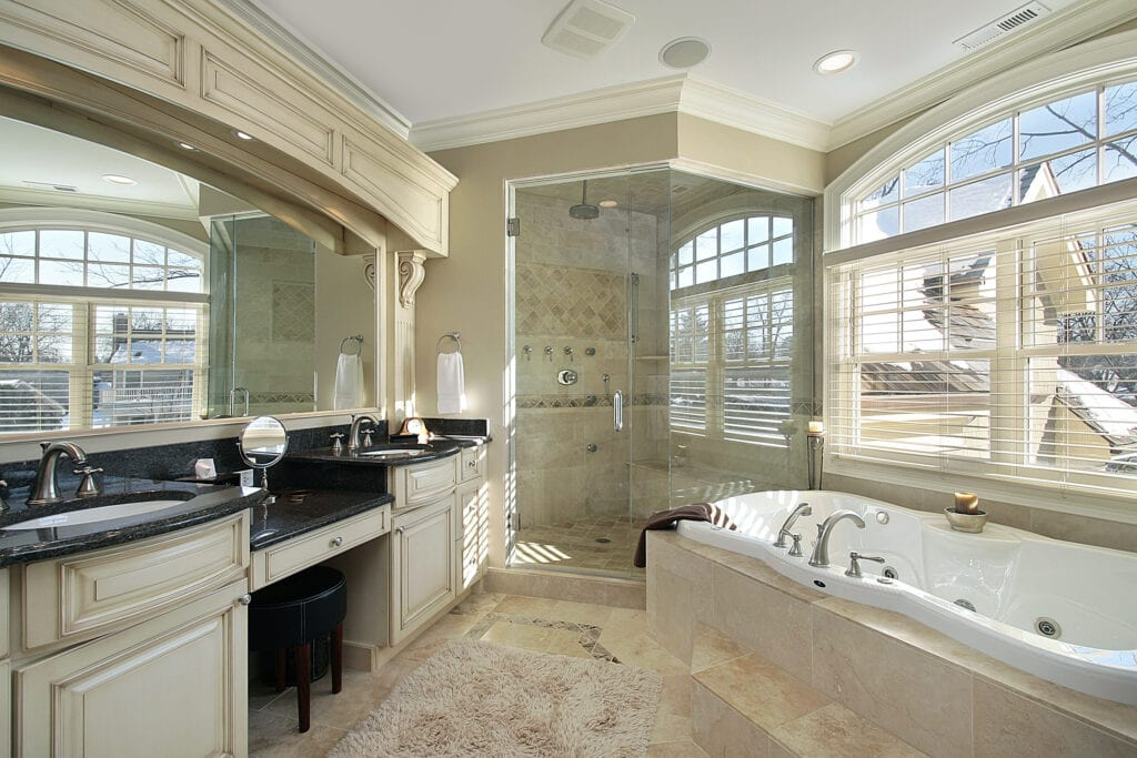 Master bath in luxury home with glass shower